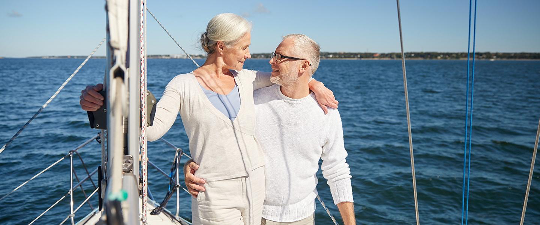 Couple in white enjoying boat slider image