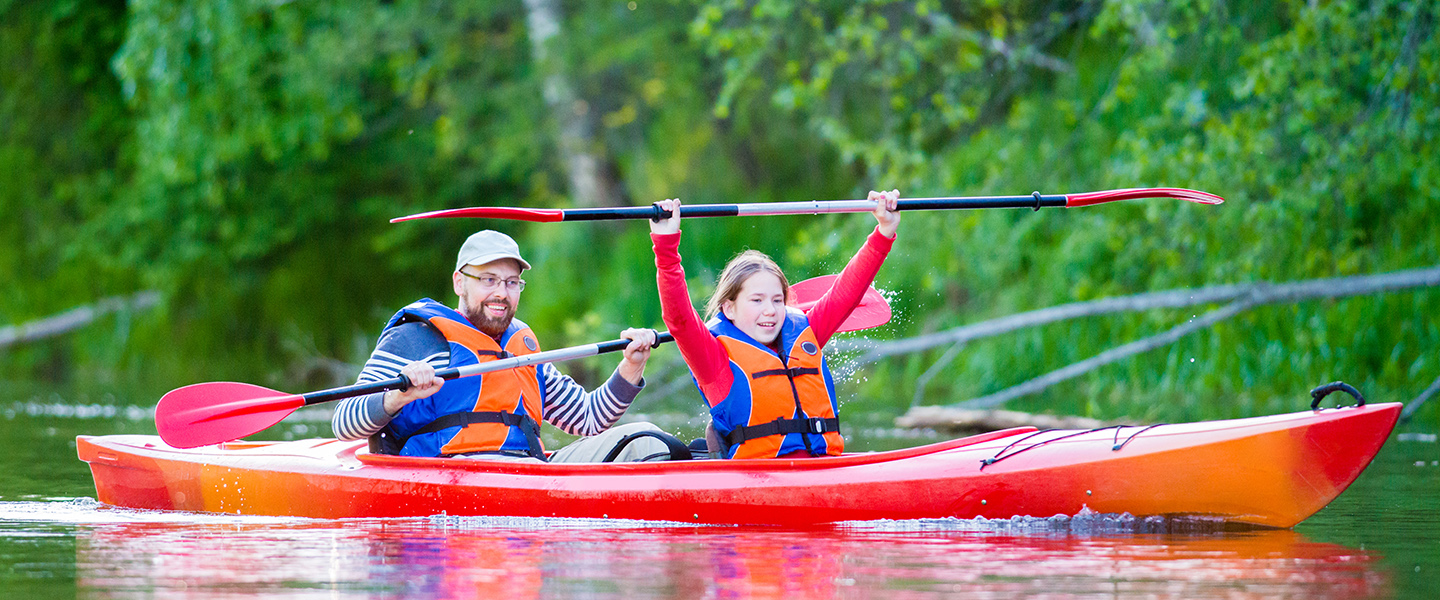 Father and daughter canoeing slider image
