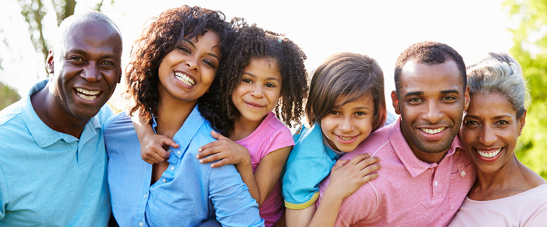 Happy, smiling family photo slider image