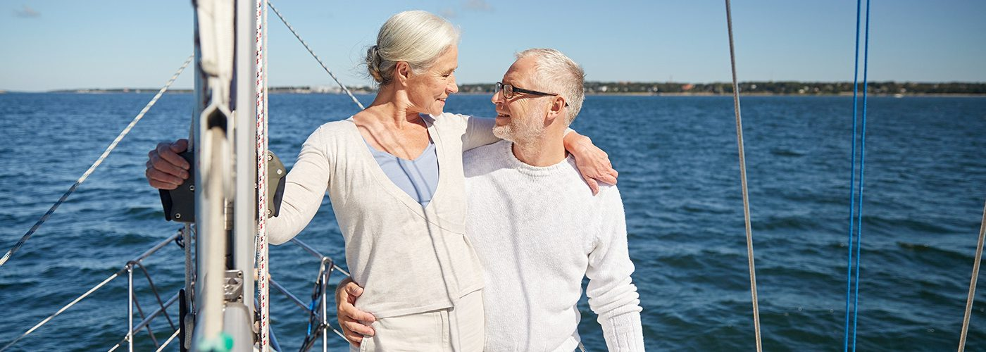 Homepage slideshow smiling sailing couple in white lifestyle image copy 2