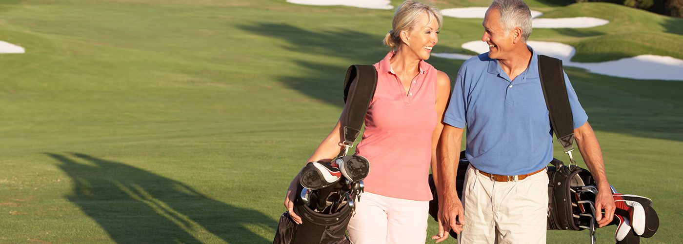 Home page slideshow smiling golfing couple lifestyle image